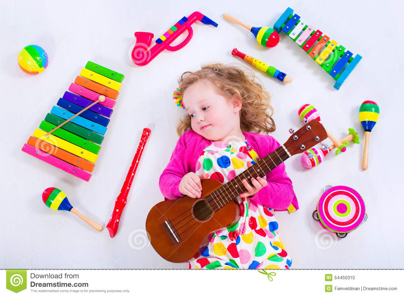 Little Girl With Music Instruments Stock Photo Image