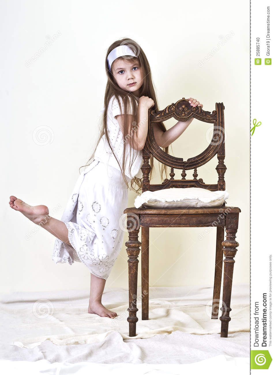 little girl is near the chair stock photo image 25885740. Black Bedroom Furniture Sets. Home Design Ideas