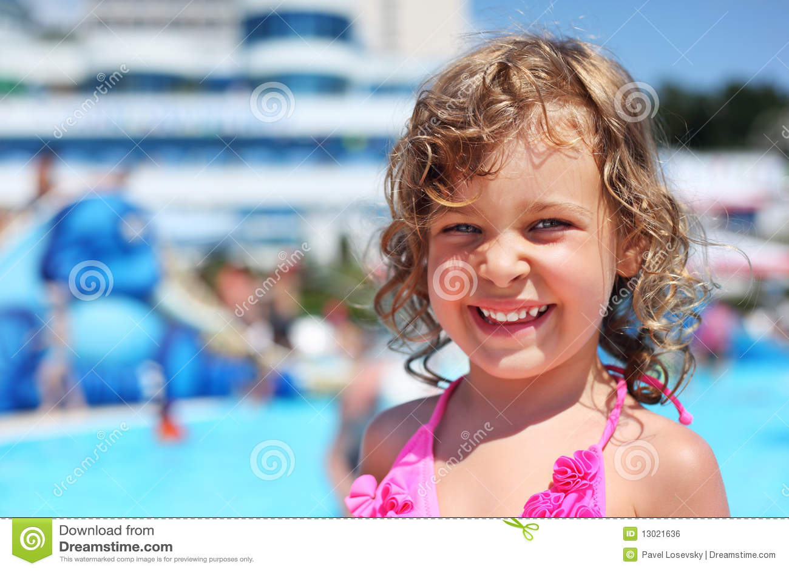 Little girl near pool in aquapark
