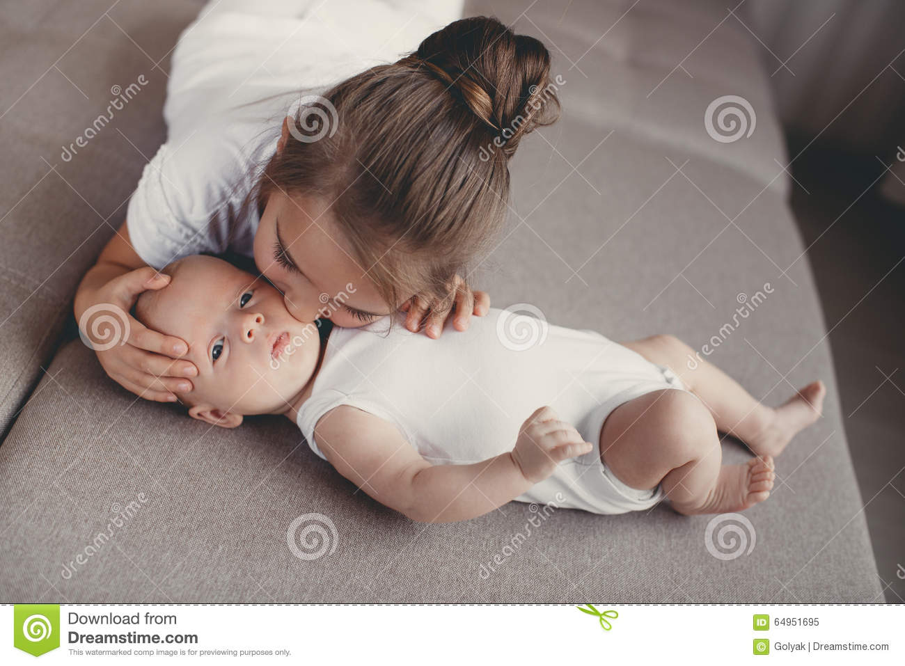little girl with a newborn baby brother stock image