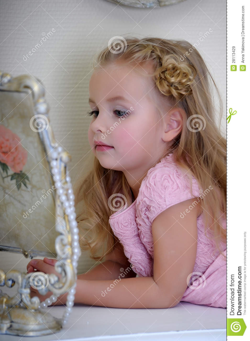 The little girl next to a mirror royalty free stock images for Mirror 7th girl