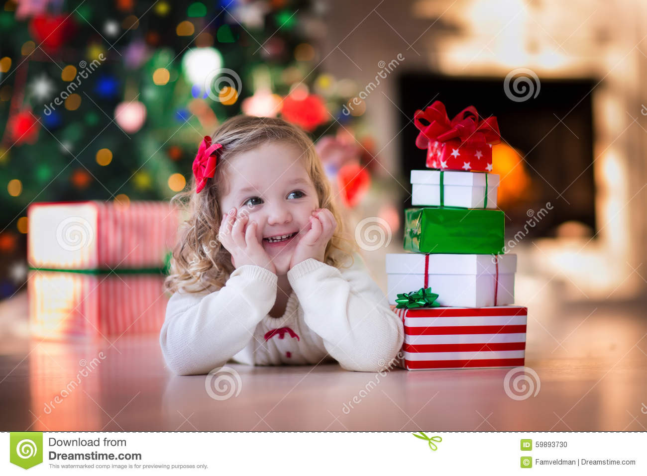 Little Girl Opening Christmas Presents At Fire Place Stock Photo ...