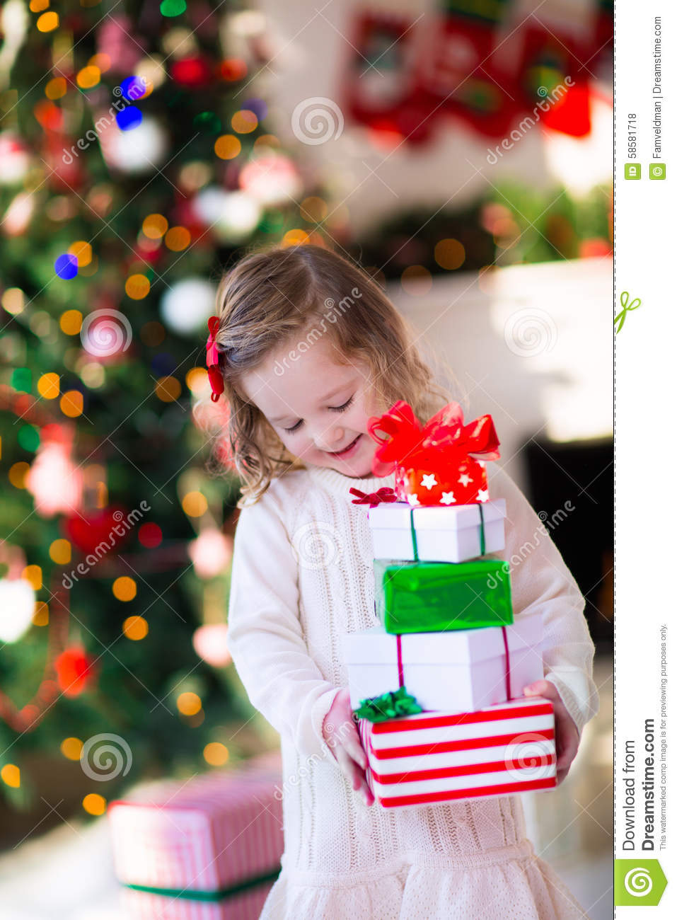 Little Girl Opening Presents On Christmas Morning Stock Photo ...