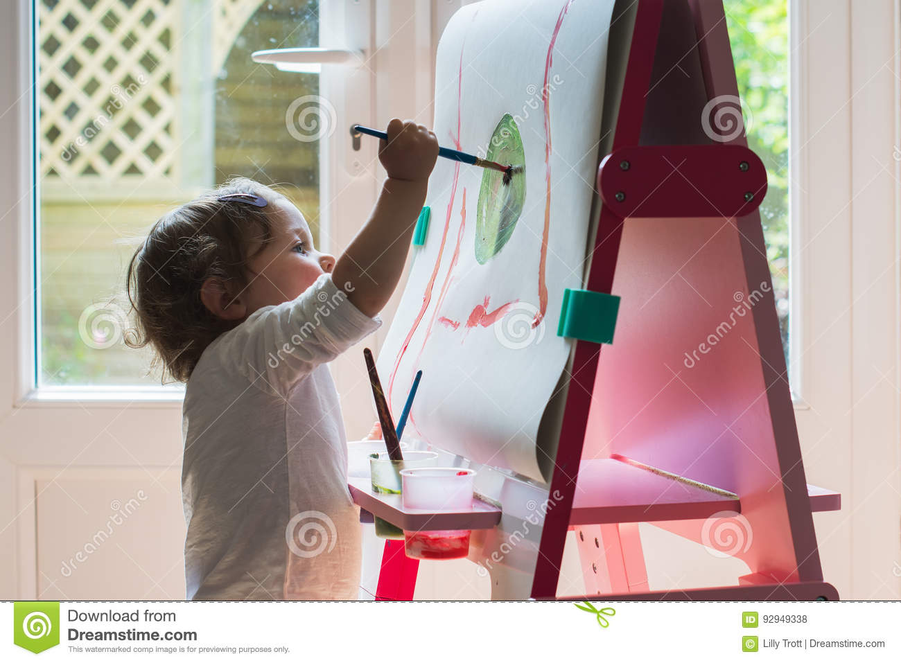 Little Girl Painting On The Easel Stock Photo Image Of Paint