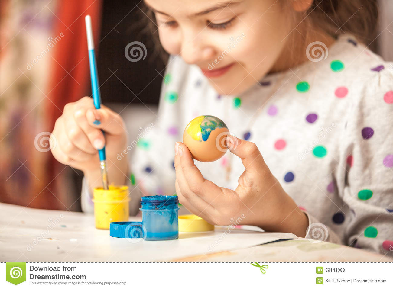Little Girl Painting Easter Egg Stock Photo