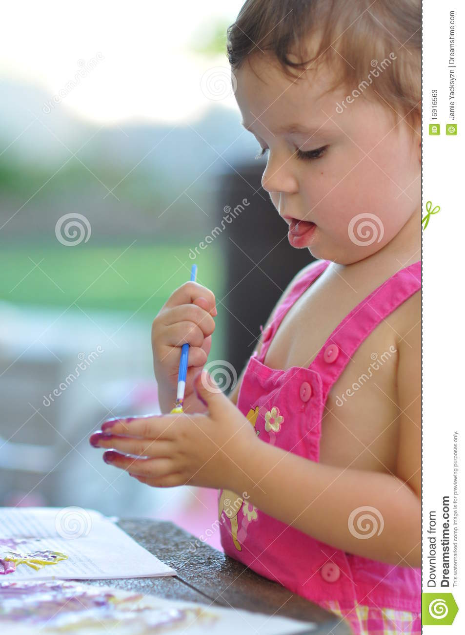 Download Little girl painting hand stock image. Image of activity - 16916563