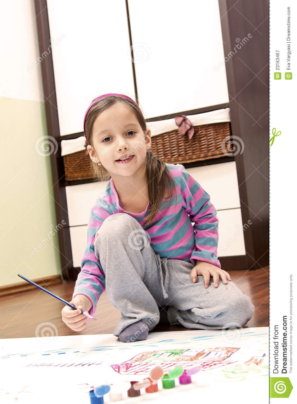 Little Girl Painting In Her Room Royalty Free Stock