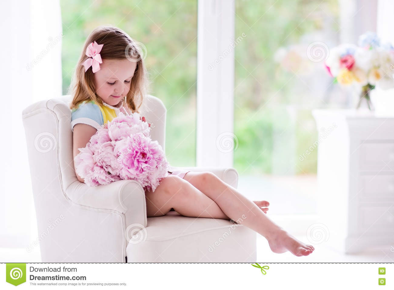 Little Girl With Peony Flowers In White Bedroom Stock Image ...