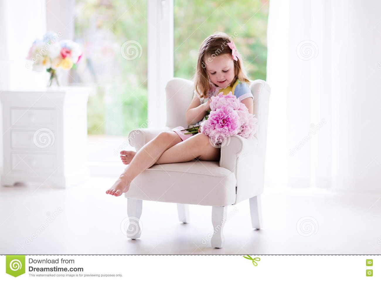 Little Girl With Peony Flowers In White Bedroom Stock Image Image