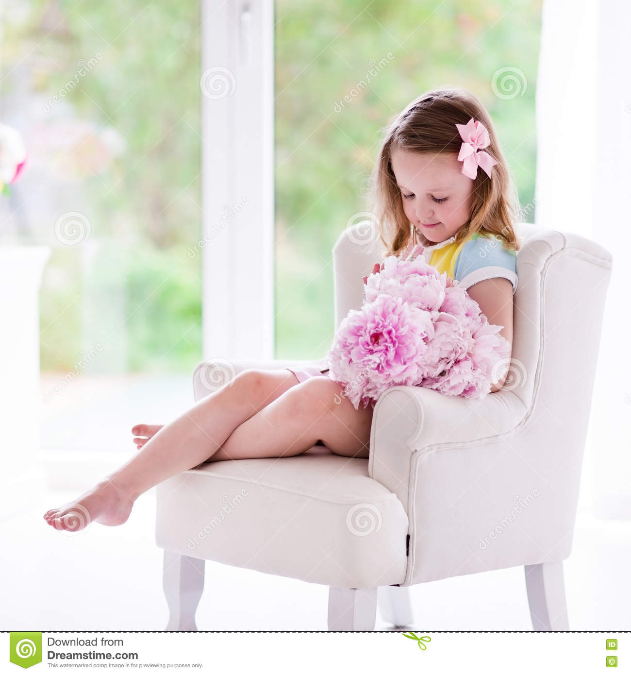 Little Girl With Peony Flowers In White Bedroom Stock Photo Image