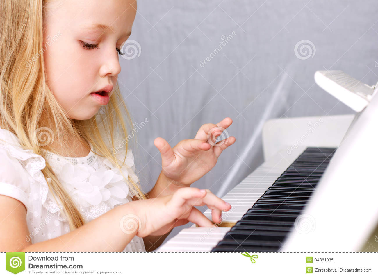 Little girl at piano