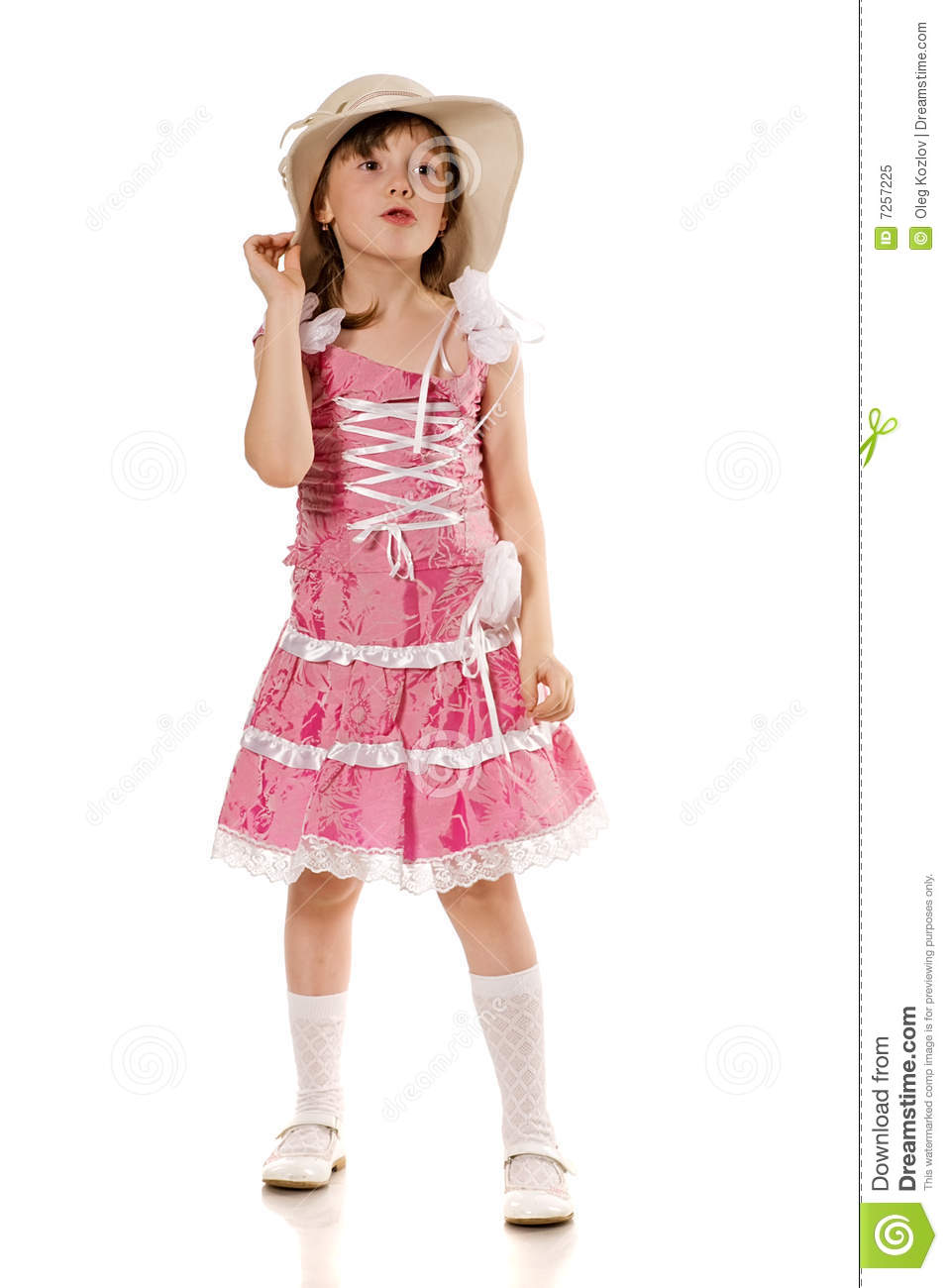 Little girl in pink dress and hat