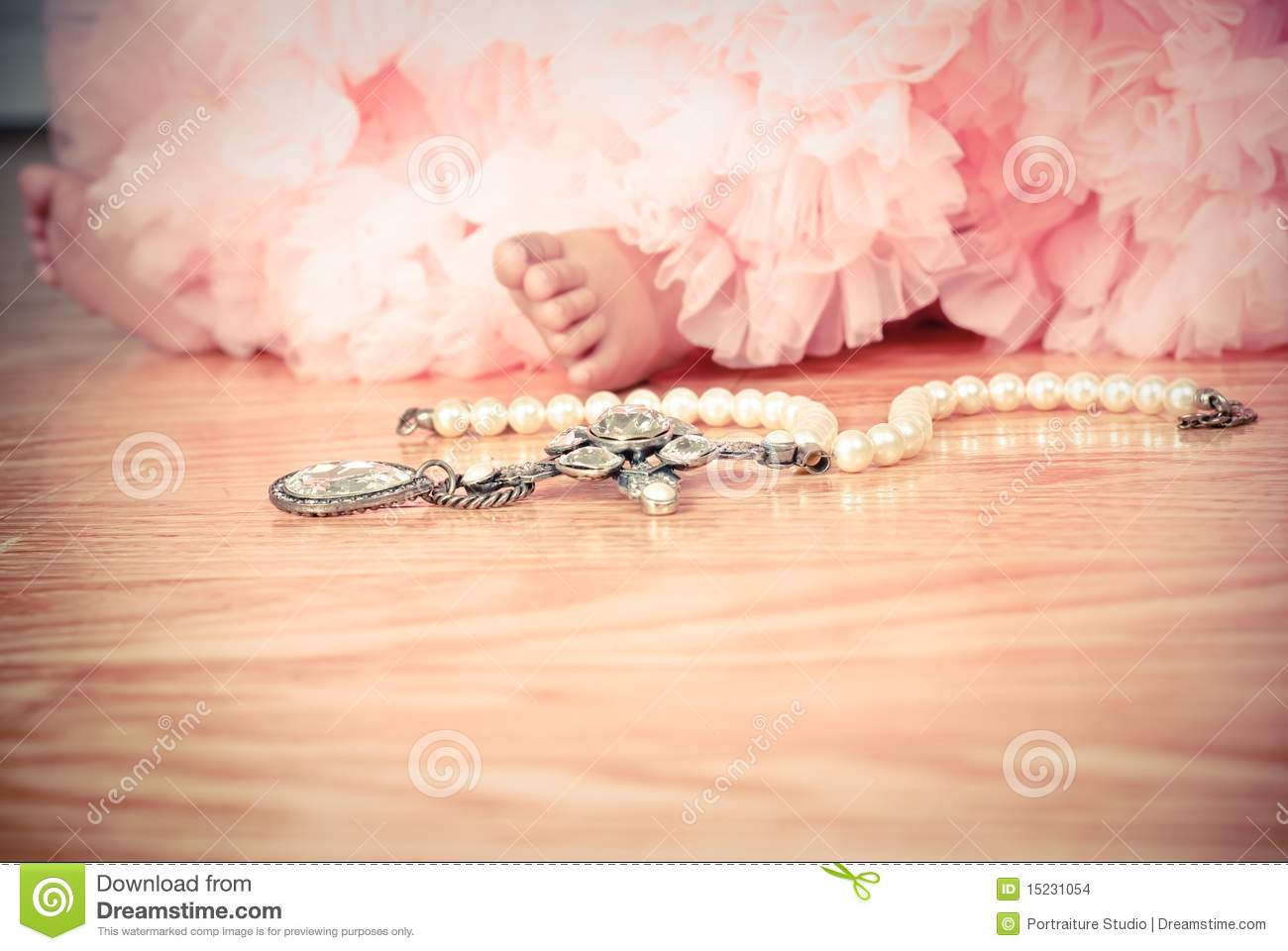 Little Girl In Pink Tulle Tutu With Pearls Stock Photo