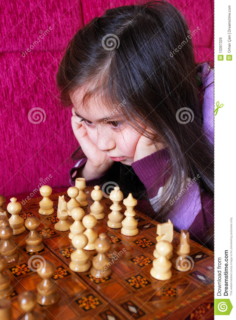 Little girl play chess game