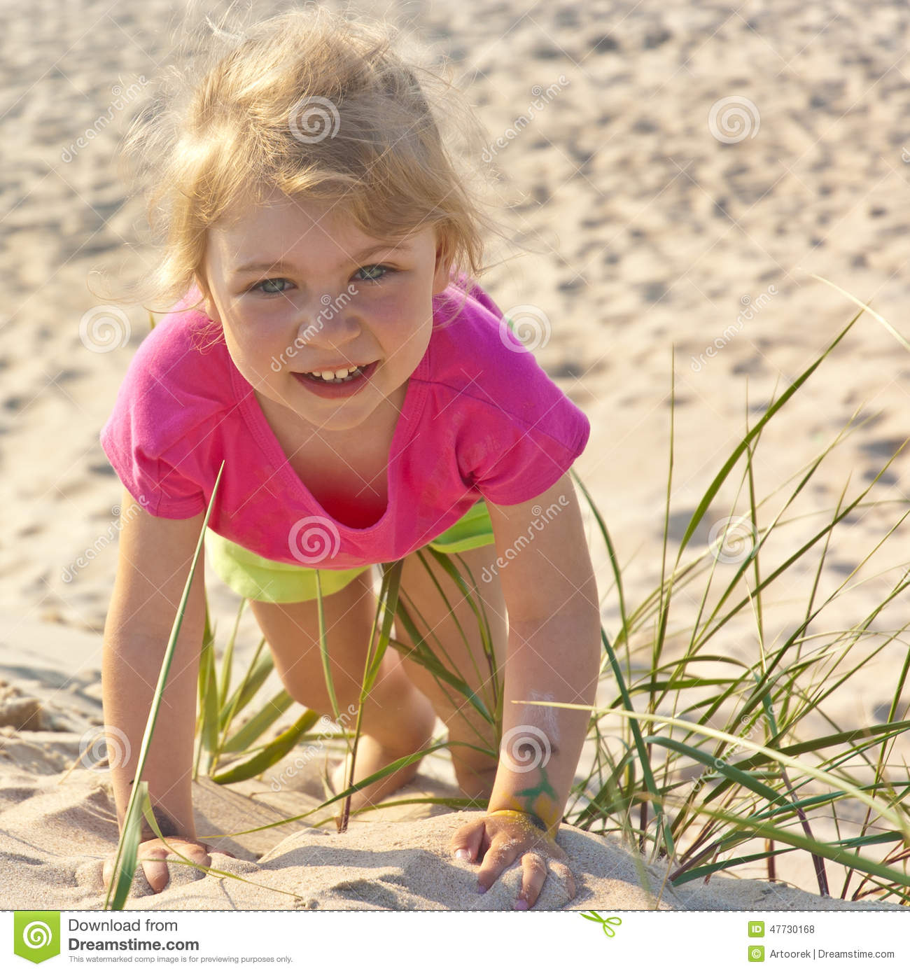 Adorable Little Girl Playing With Beach Toys During: Little Girl Playing In The Beach Sand Stock Photo