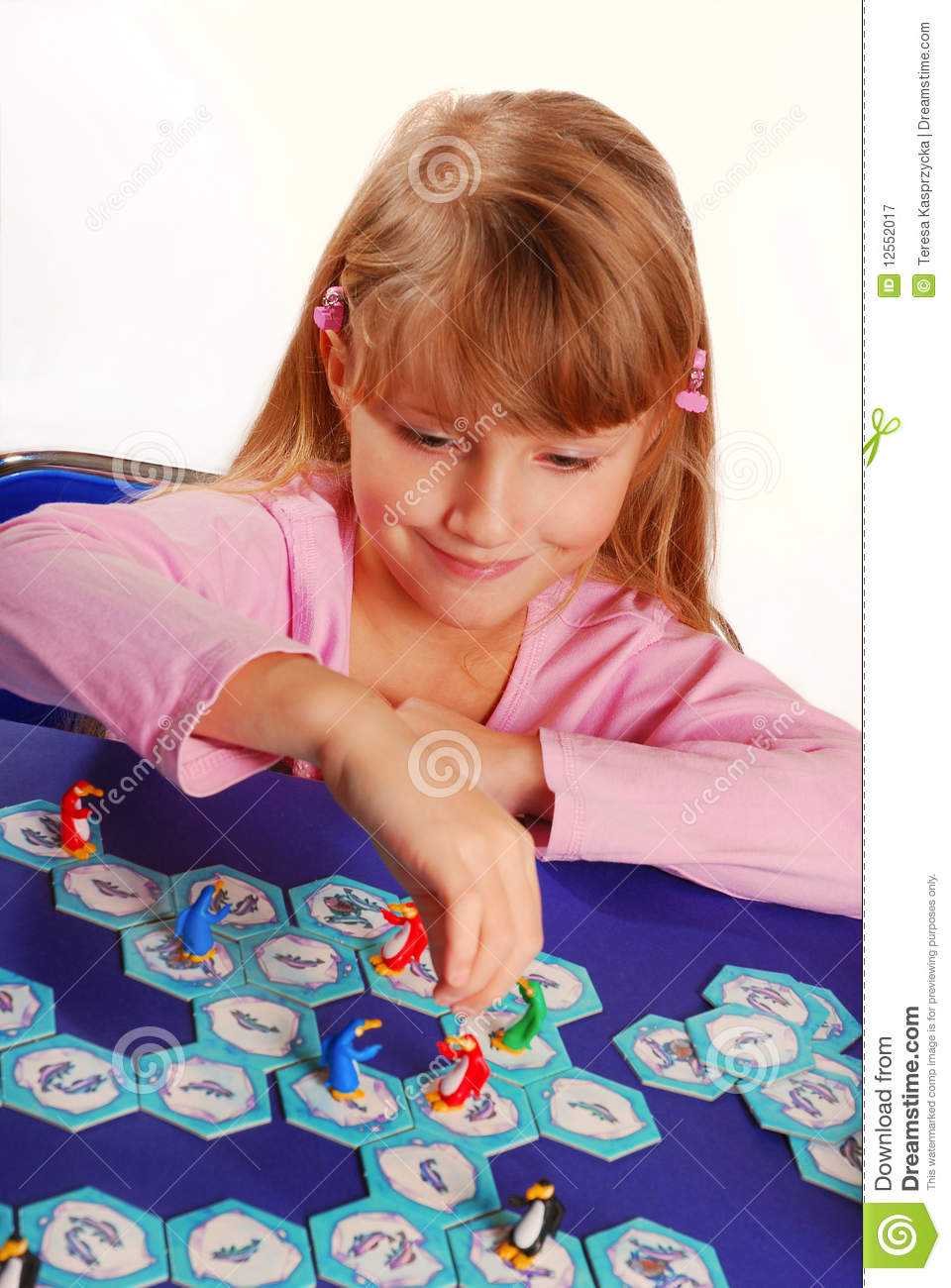 little girl playing the board game royalty free stock photography image 12552017. Black Bedroom Furniture Sets. Home Design Ideas