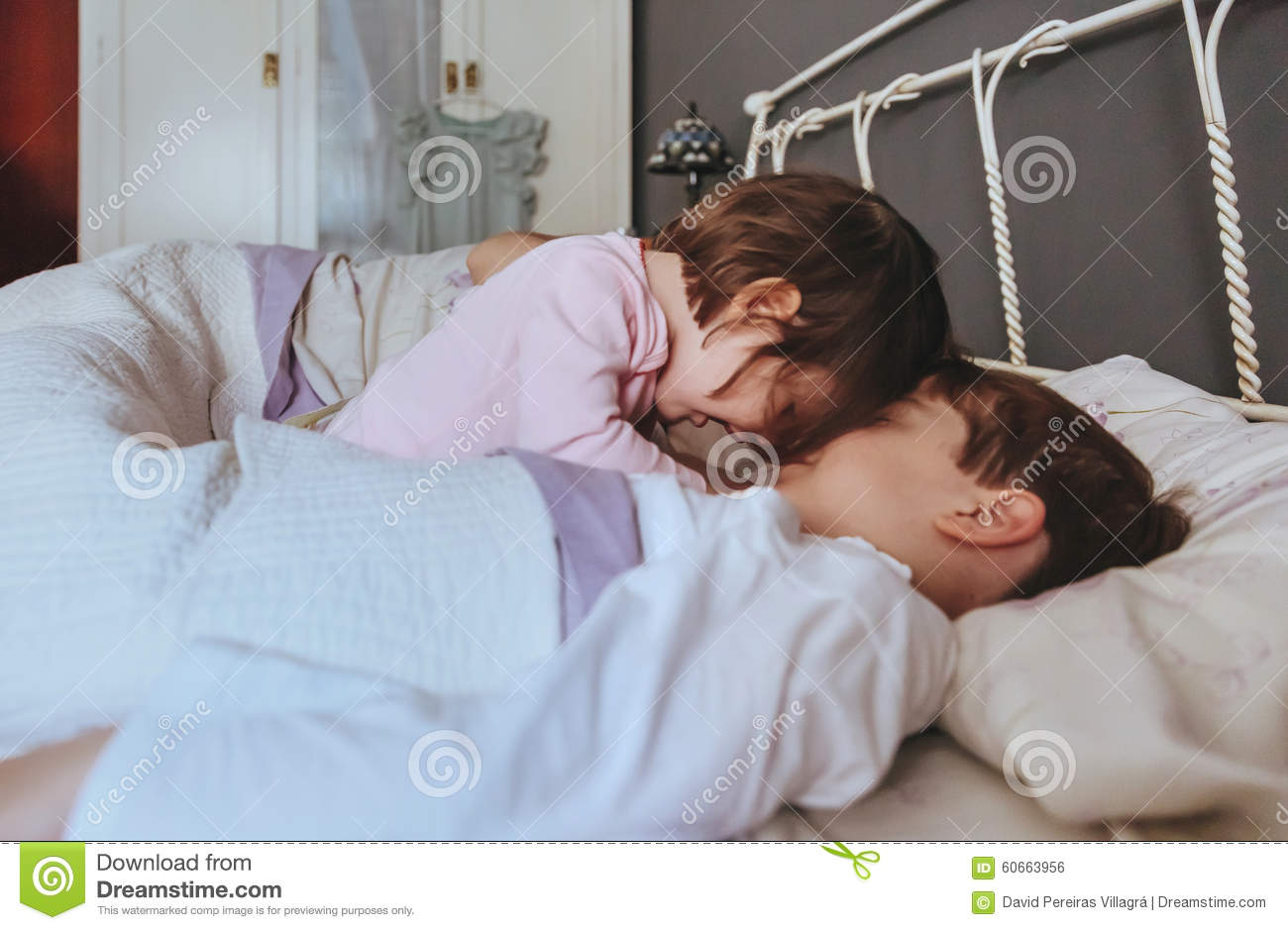 Little Girl Playing With Boy Over The Bed Stock Photo Image Of