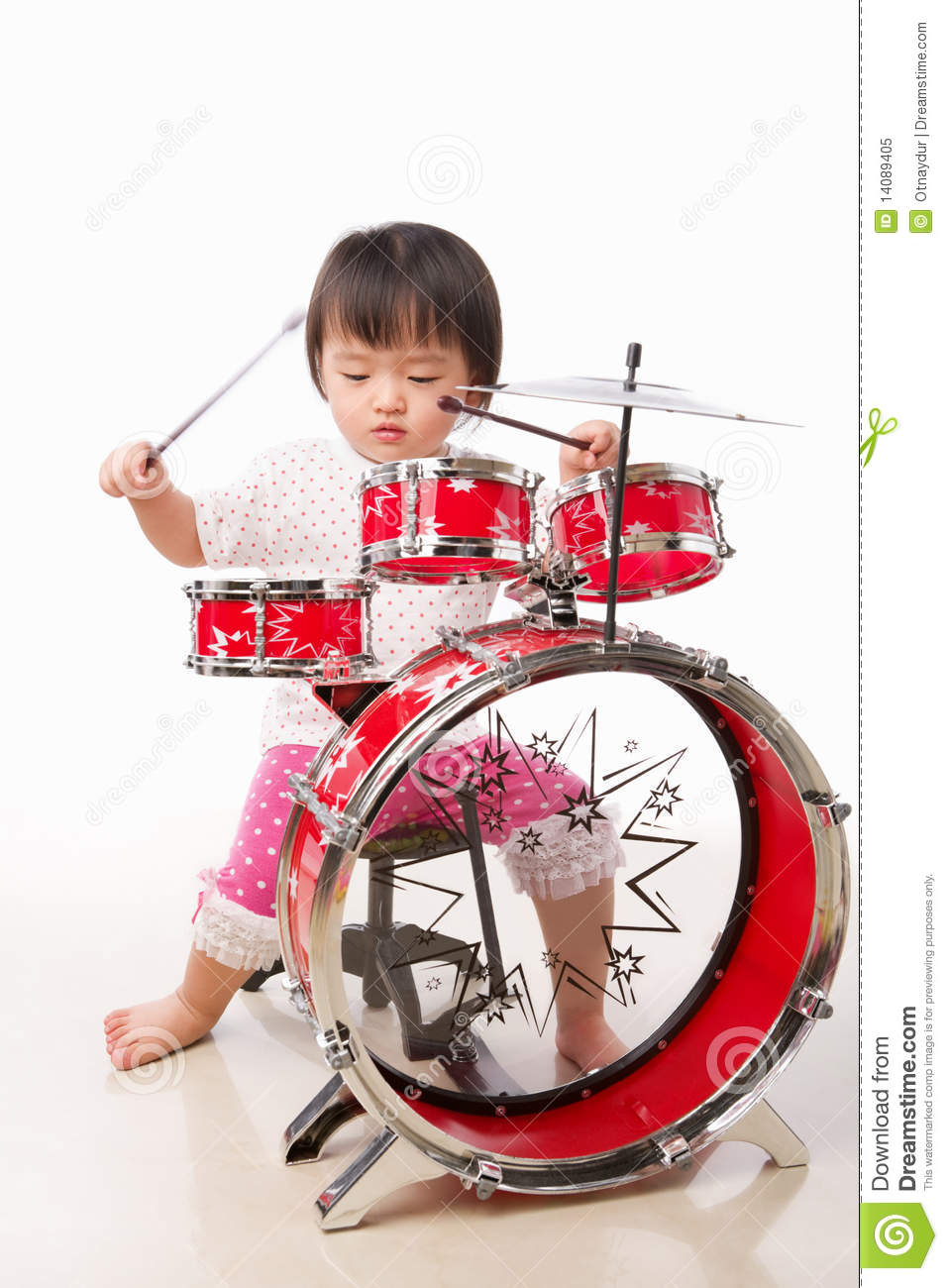 Kid Playing Drums Little girl playing drum