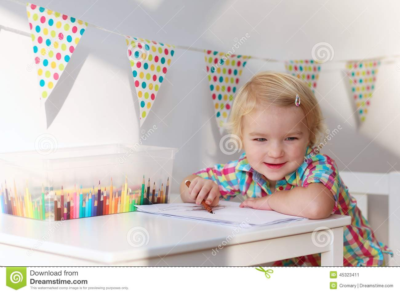 Little Girl Playing Indoors Drawing With Colorful Pencils
