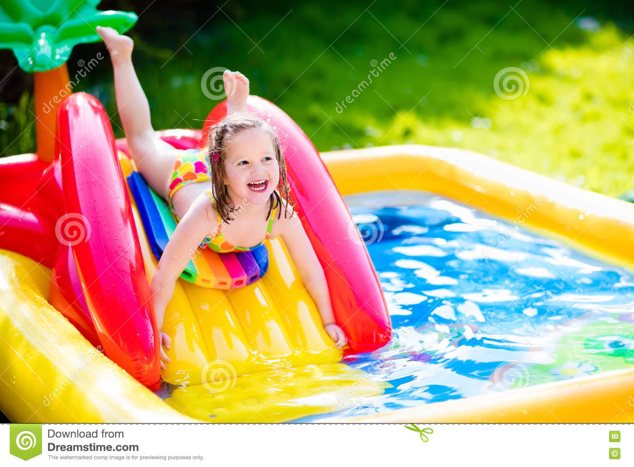 Little Girl Playing In Inflatable Garden Swimming Pool Stock Image Image 71316519