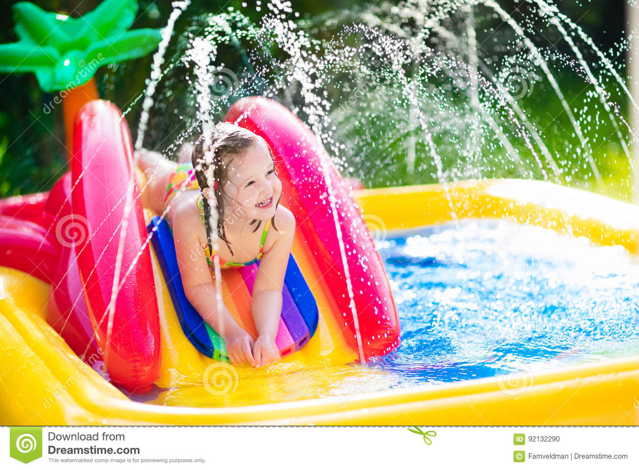 Little Girl Playing In Inflatable Garden Swimming Pool Stock Photo Image 92132290