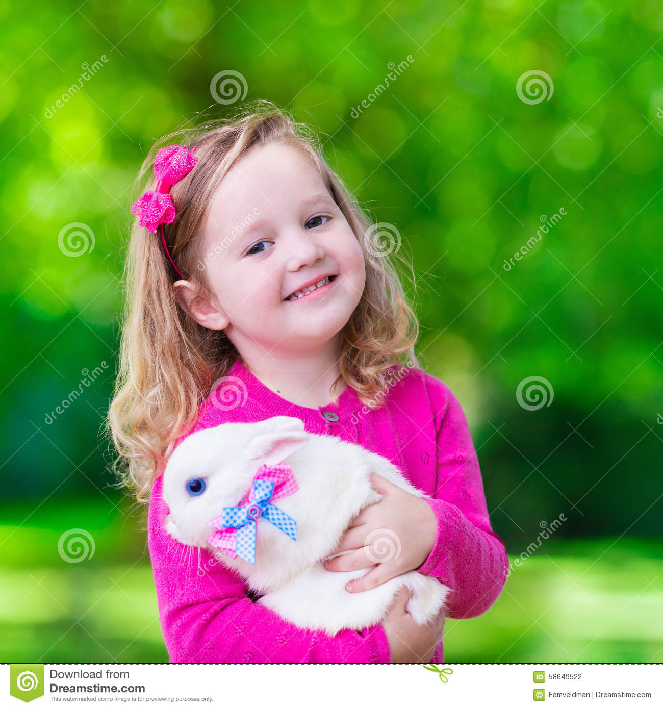 Baby Girl Wallpaper: Little Girl Playing With Rabbit Stock Photo
