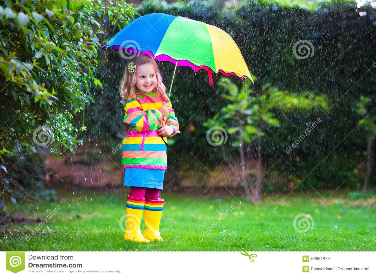 Girl playing in the rain
