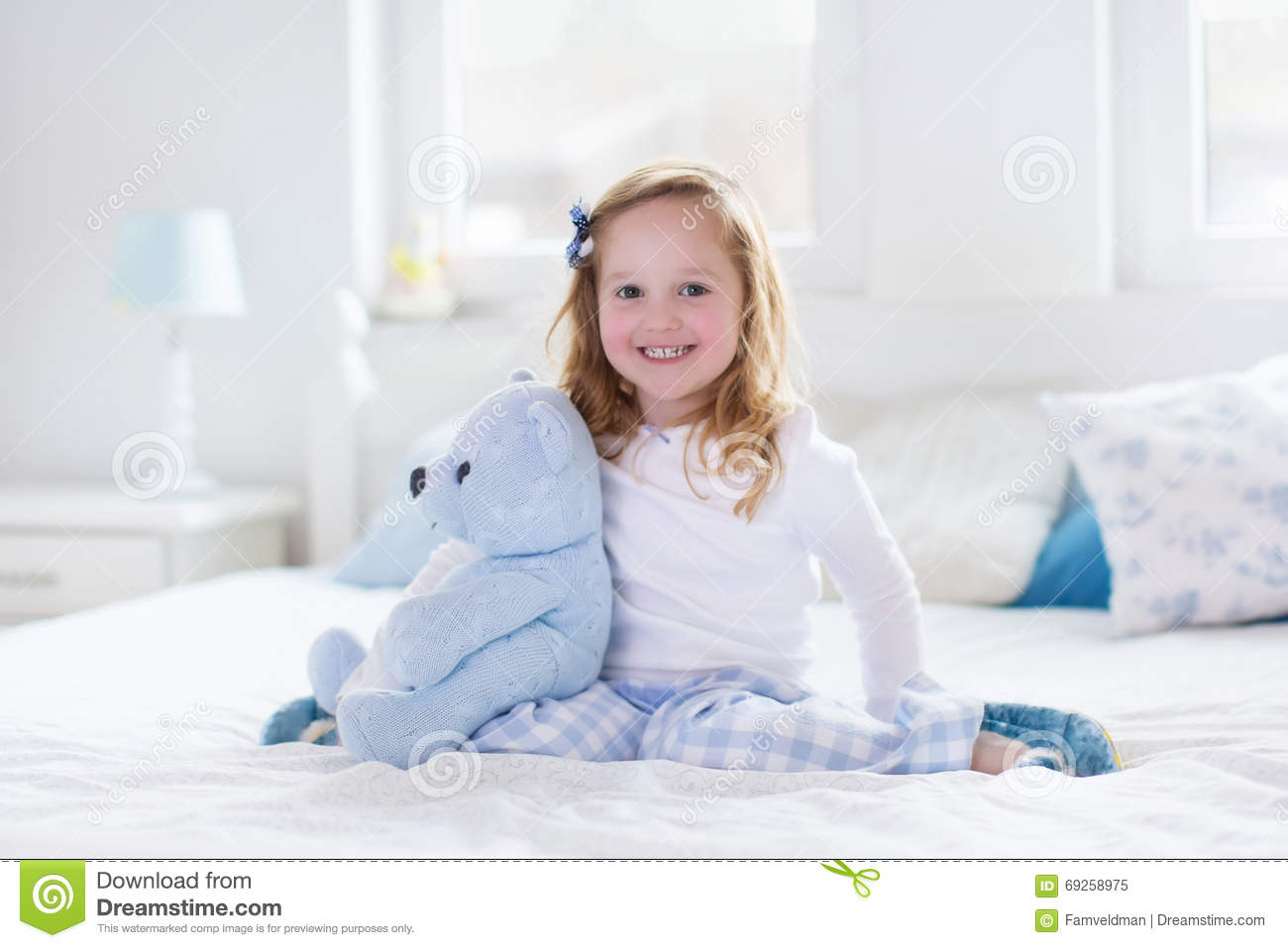 Happy Baby Laughing With Teddy Bear In Bed Stock Image