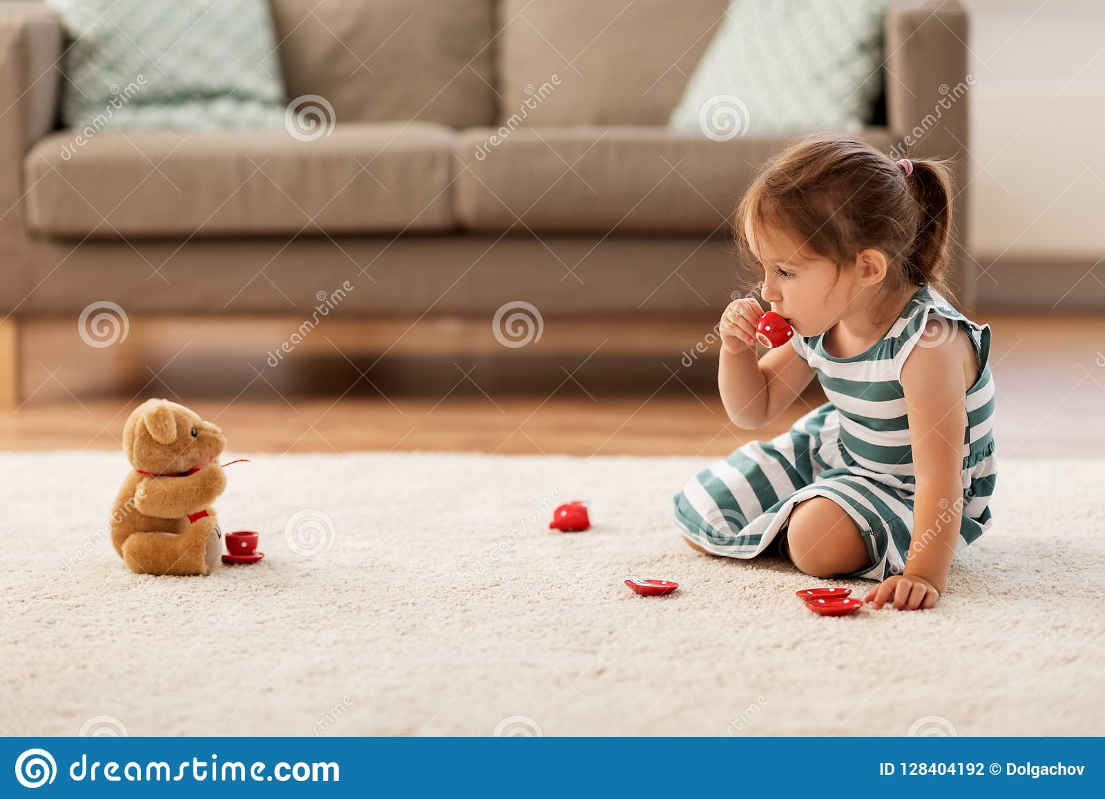 Little Girl Playing With Toy Tea Set At Home Stock Photo Image Of