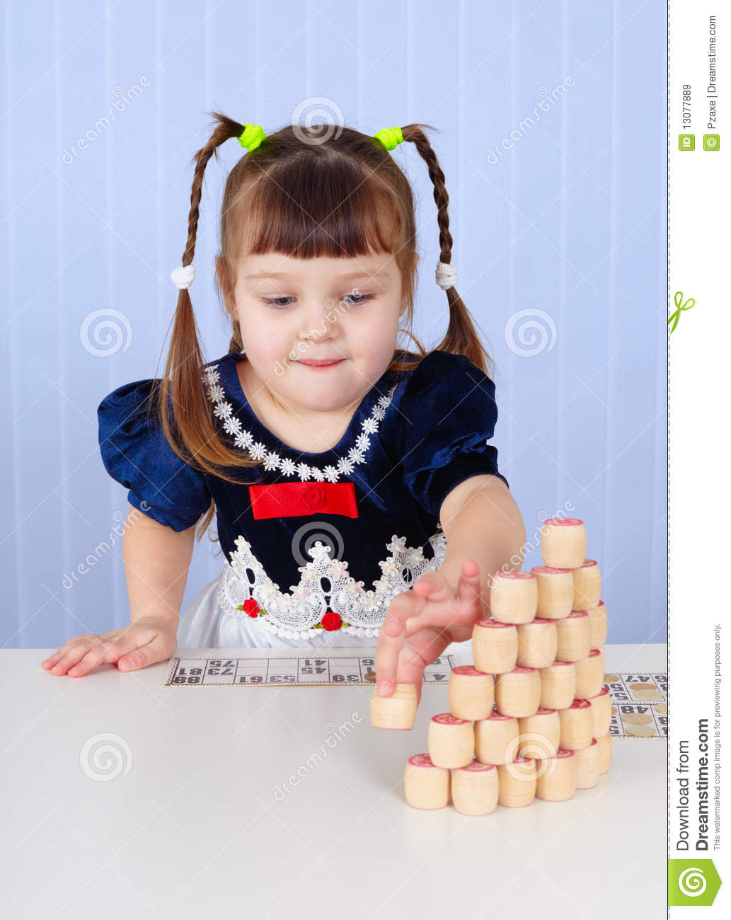 Little Girl Toys : Little girl playing with toys on table royalty free stock