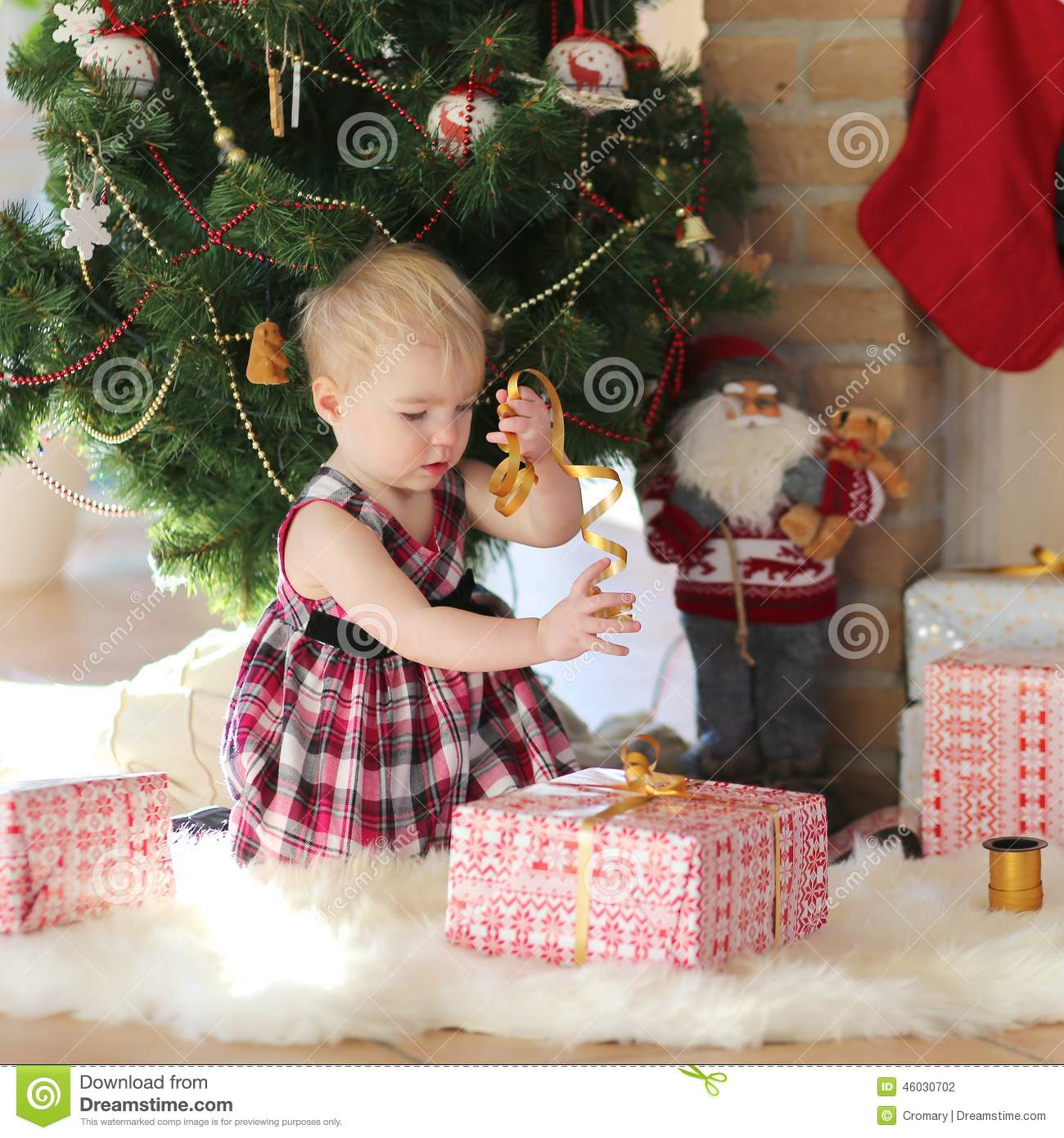 Little Girl Christmas Tree: Little Girl Playing Under Christmas Tree On Sunny Winter
