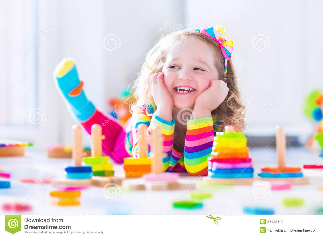 Little Girl Toys : Little girl playing with wooden toys royalty free stock