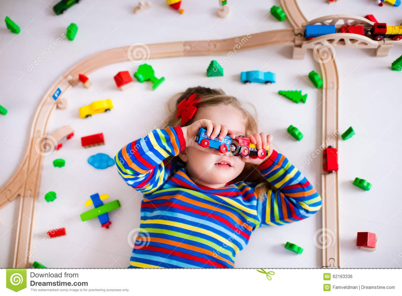 Little Girl Playing With Wooden Trains Stock Photo Image Of Funny