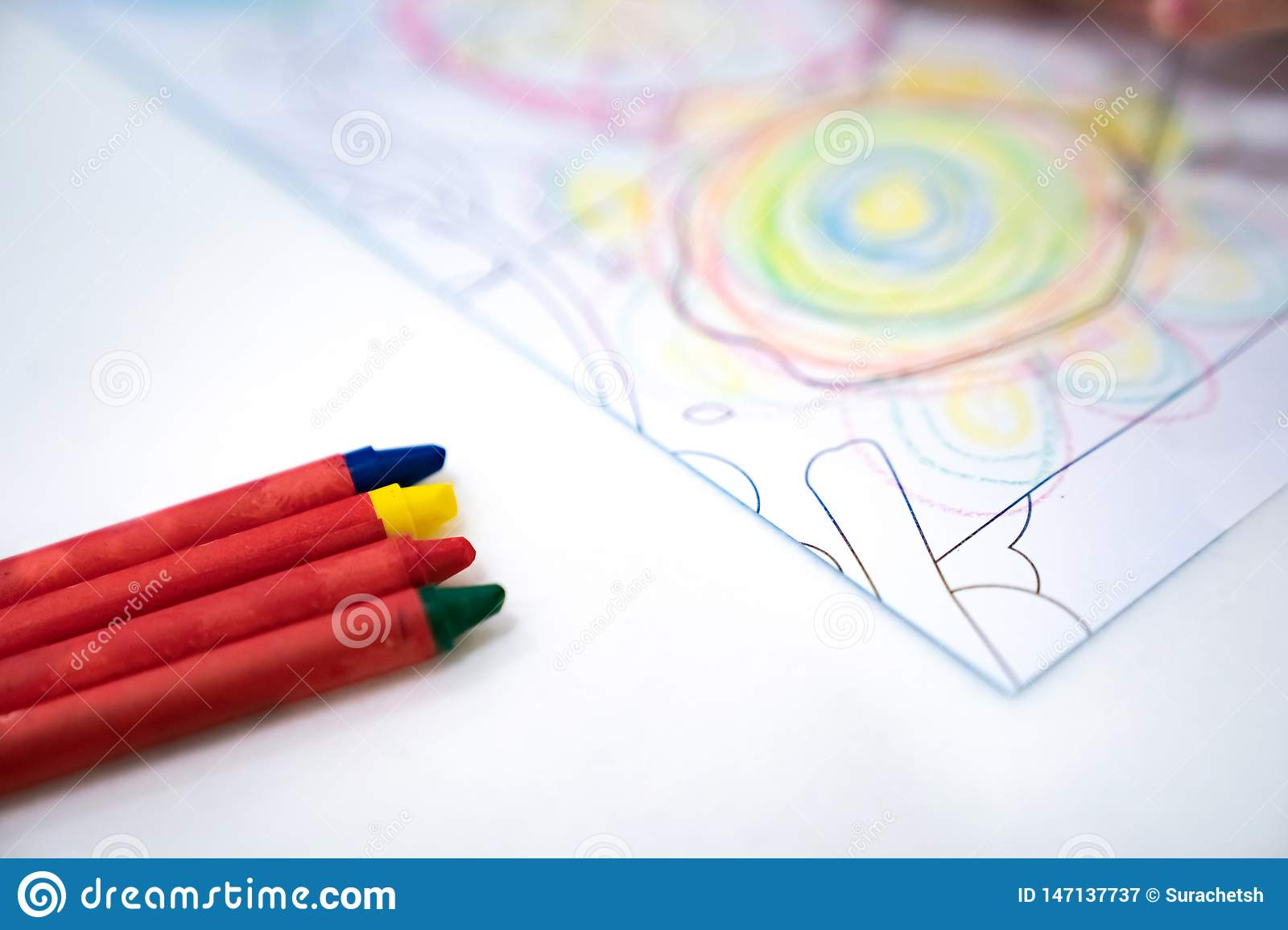 Little Girl Plays And Learns To Coloring Crayon On The Paper ...