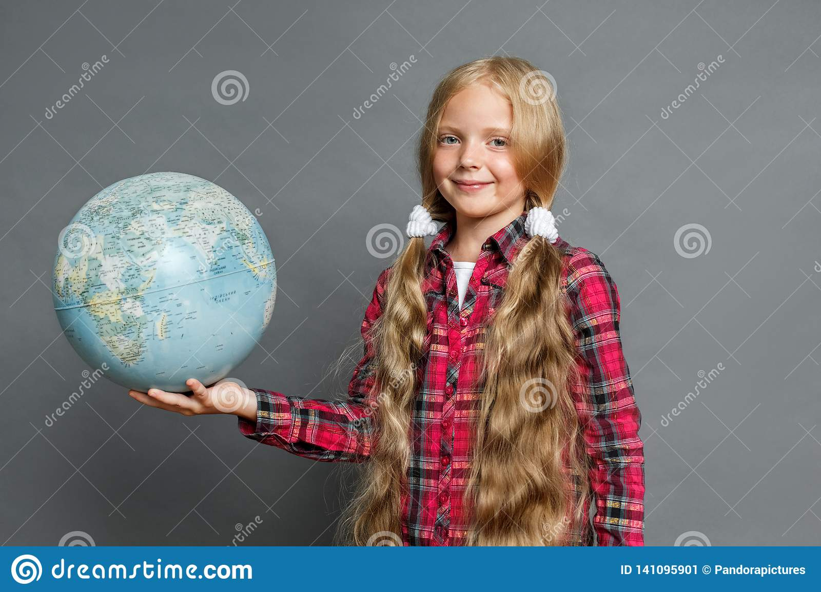 Terrific Little Girl With Ponytails Standing Isolated On Grey With Globe Schematic Wiring Diagrams Phreekkolirunnerswayorg