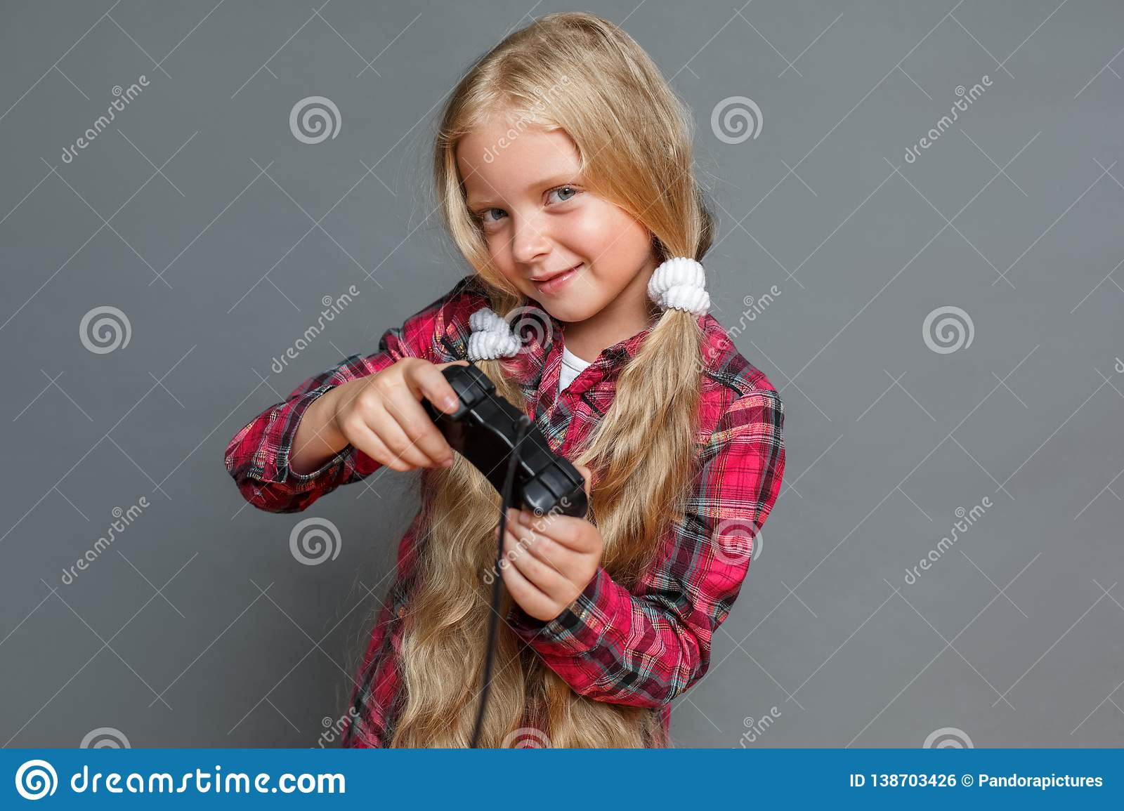 Stupendous Little Girl With Ponytails Standing Isolated On Grey Playing Game Schematic Wiring Diagrams Phreekkolirunnerswayorg