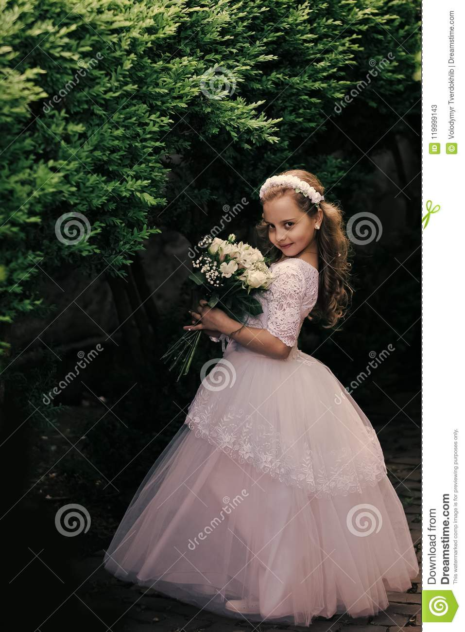 Little Girl Is Posing In Evening Dress Bride Girl Bridesmaid And