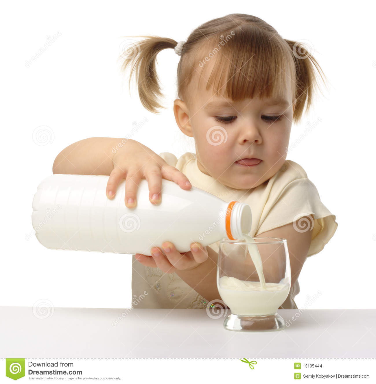 Little Girl Pouring Milk In Glass Stock Images - Image: 13195444