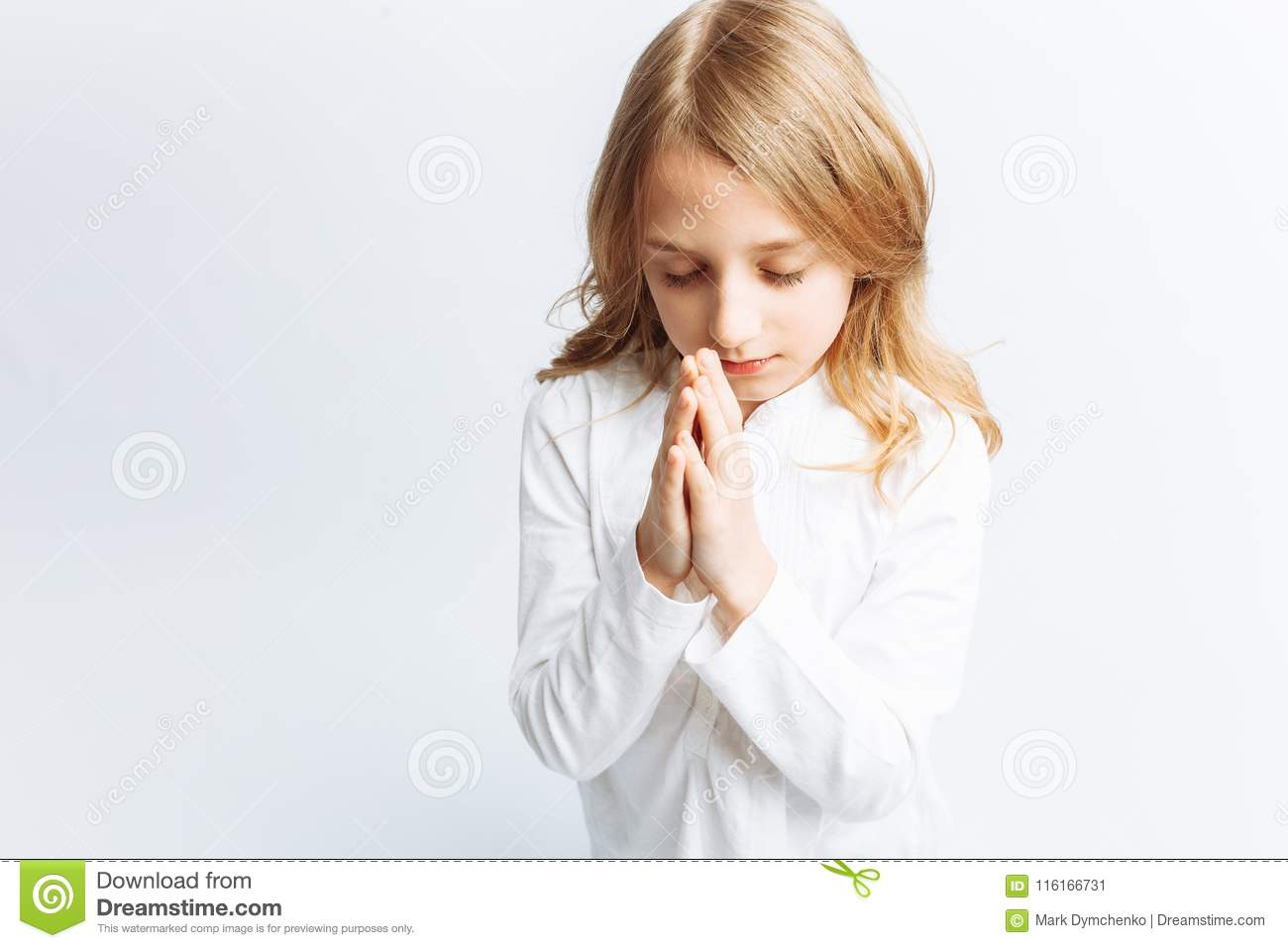 Little Girl Praying On Her Knees To God Isolated Background