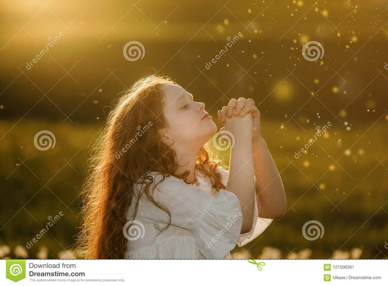 Cute girl with praying. Peace, hope, dreams concept.