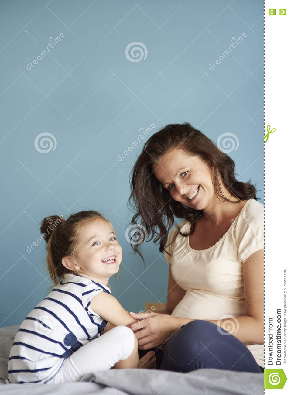 Little Girl With Pregnant Mom Stock Photo - Image of front
