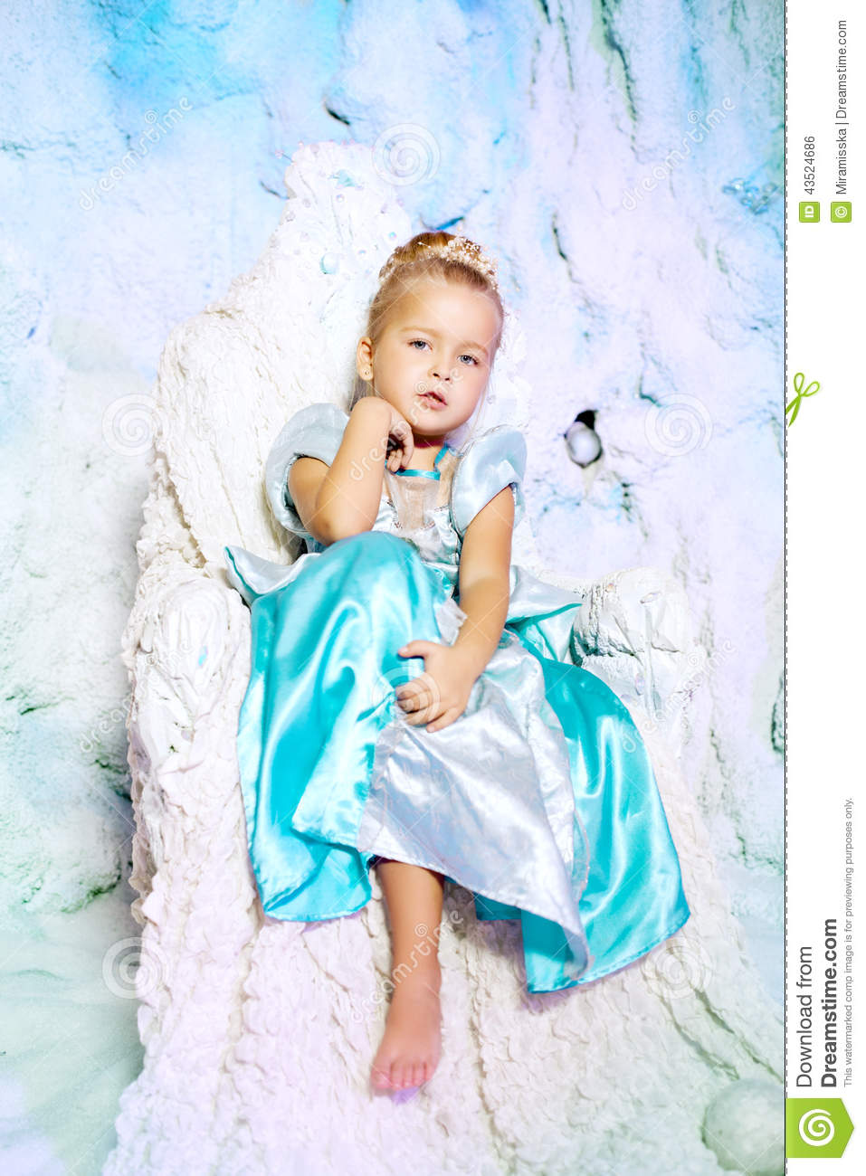 Little girl in princess dress on a background of a winter fairy