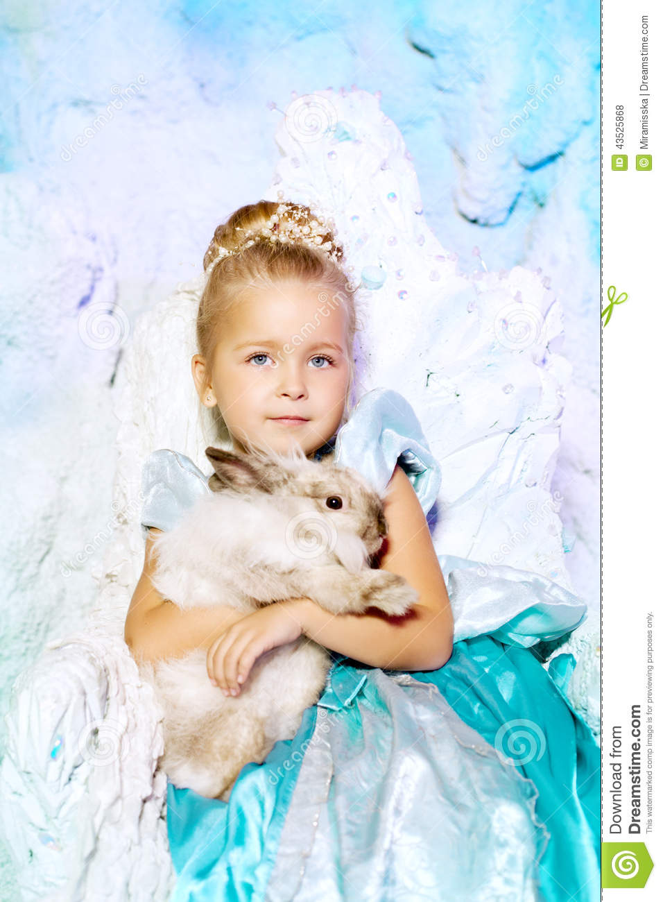 Little girl in princess dress on a background of a winter fairy cheerful holiday