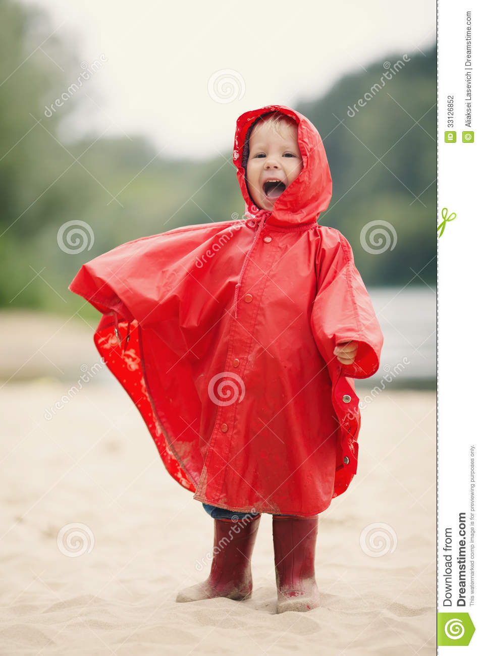 Little Girl With Raincoat Stock Photography Image 33126852