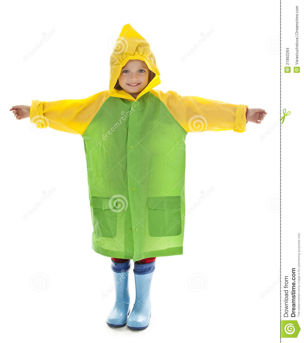 Little girl with raincoat and rubber boots