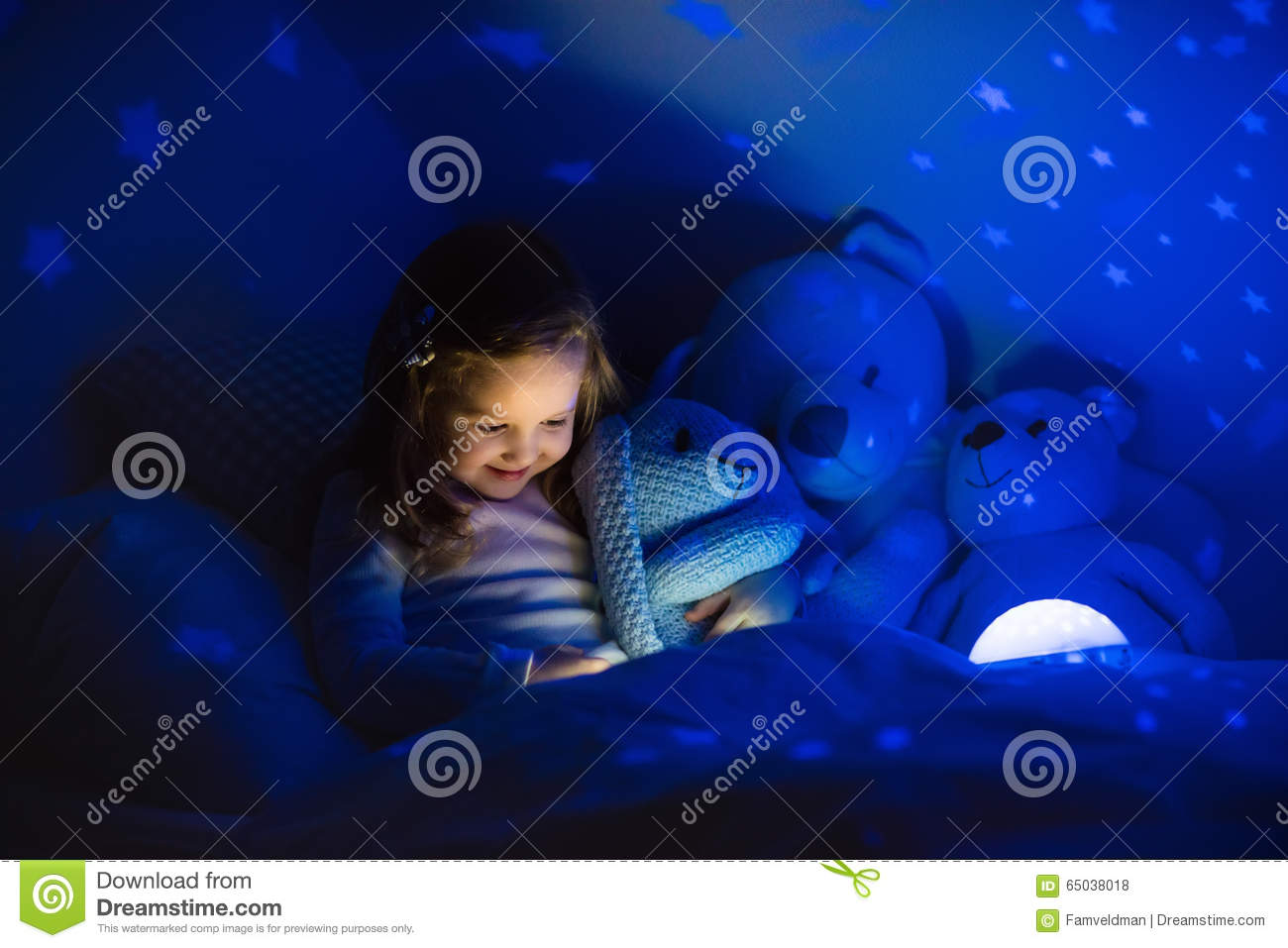 Little Girl Reading A Book In Bed Stock Photo Image Of