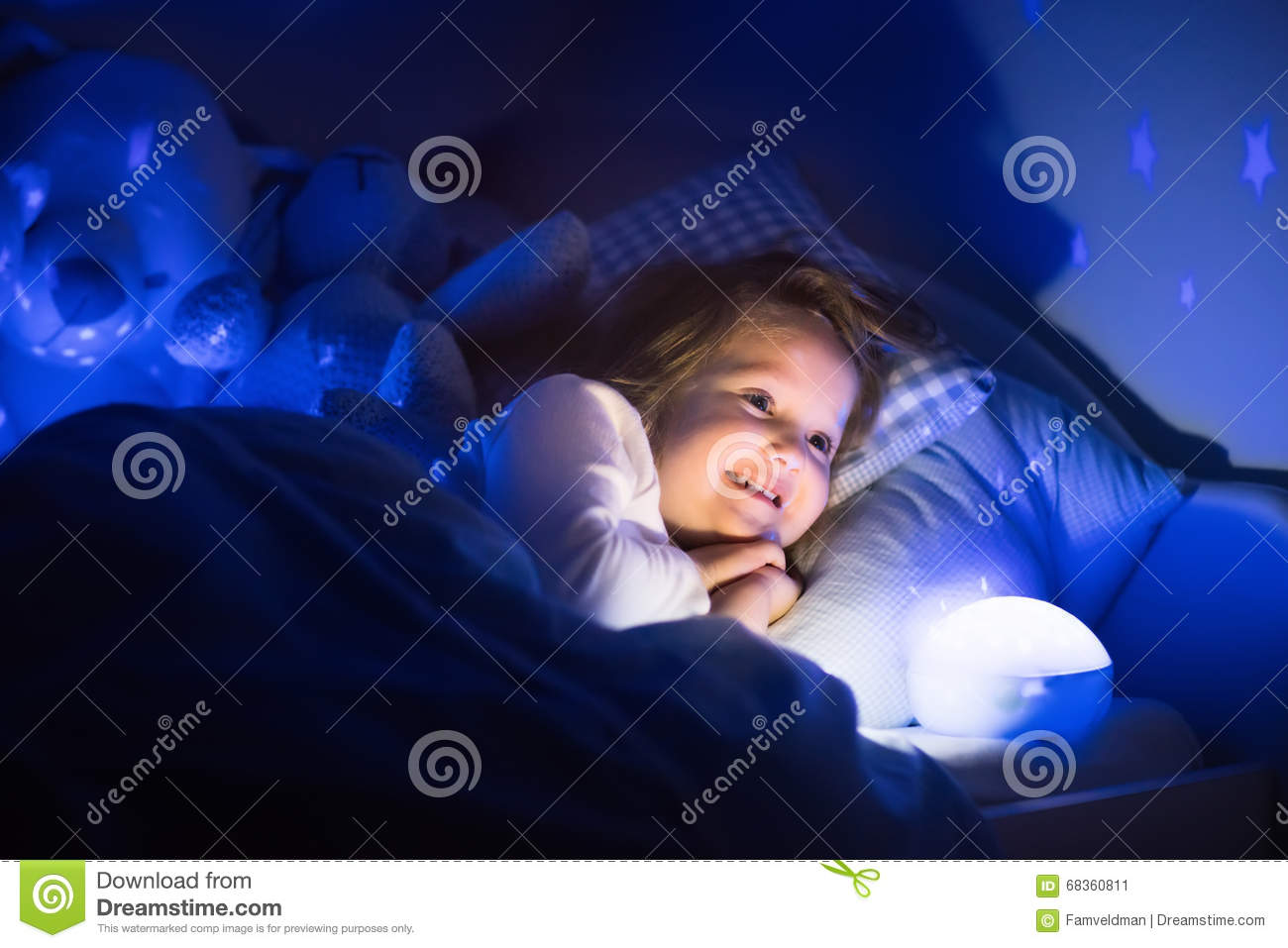 Little Girl Reading A Book In Bed Stock Photo Image 68360811
