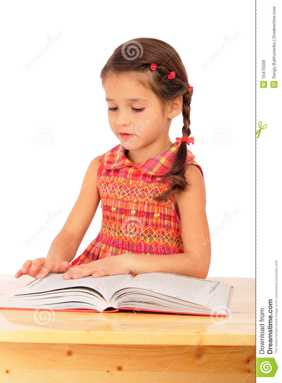 Little Girl Reading Book On The Desk Royalty Free Stock Image - Image ...