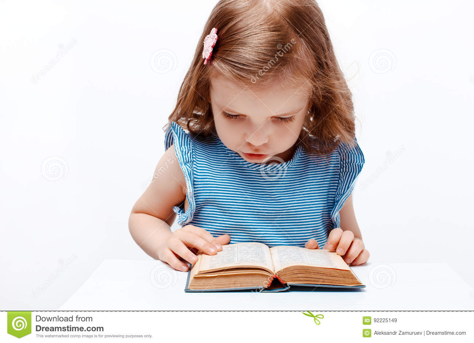 Little girl reading book. on white background