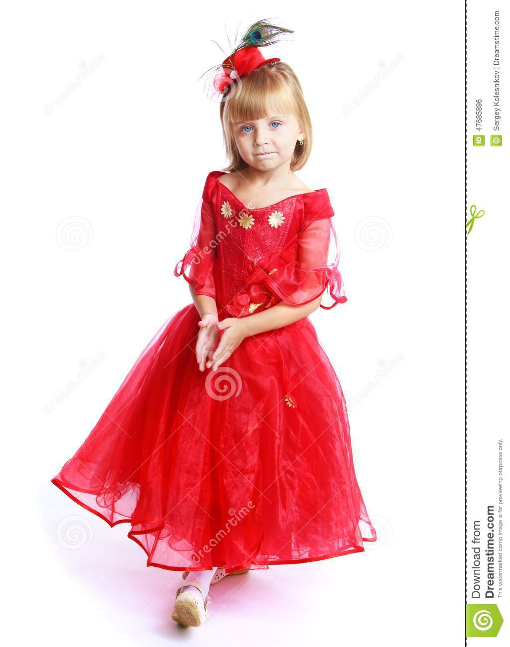 d5b8dffb8552 Preparing for Christmas, holiday, baby joy concept .Charming little girl in  a bright red dress.Isolated on white background.
